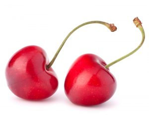 Two heart shaped cherry berries isolated on white background cut