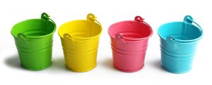 Four buckets of different colours, isolated on white