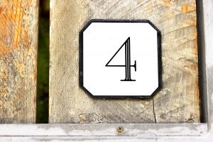 Number 4 on textured wooden wall
